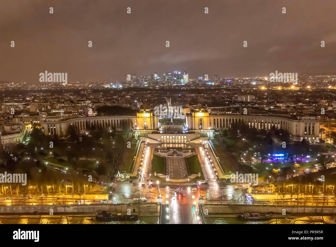Aerial view of Trocadero at cloudy and rainy night - Stock Image