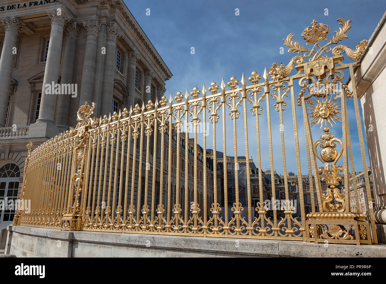 Golden fence in exterior facade of Versailles Palace, Paris, France - Stock Image
