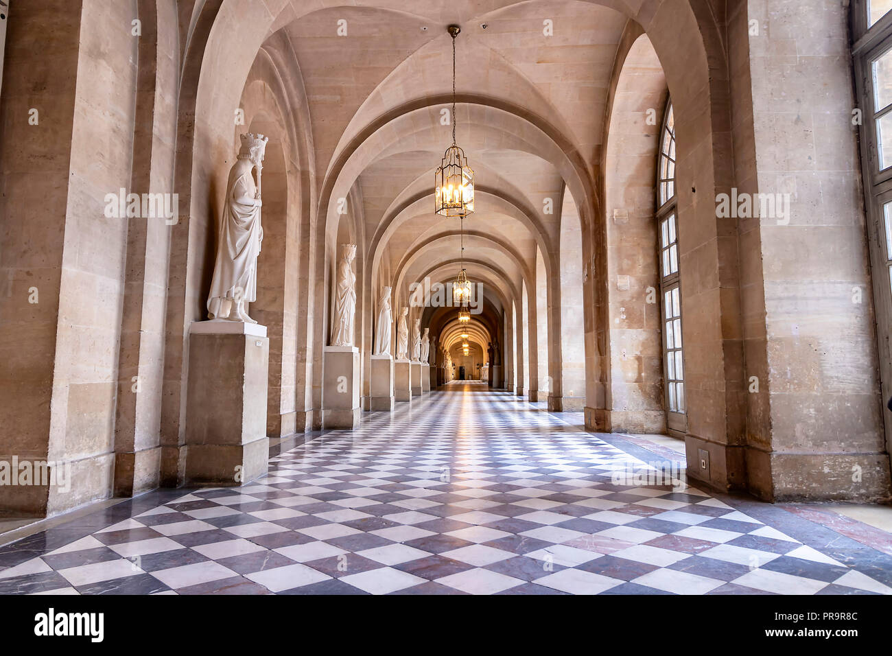 Versailles, France - March 14, 2018: An empty long corridor inside of the Royal Palace of Versailles in France Stock Photo