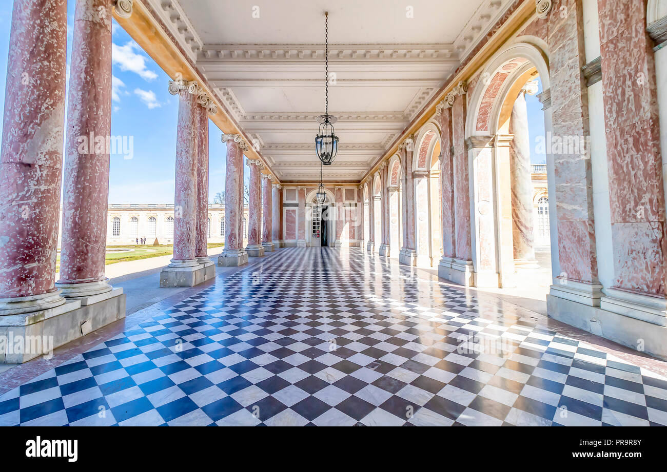 Corridors of the Grand Trianon in the Palace of Versailles, France. The Palace of Versailles is a royal chateau - Stock Image