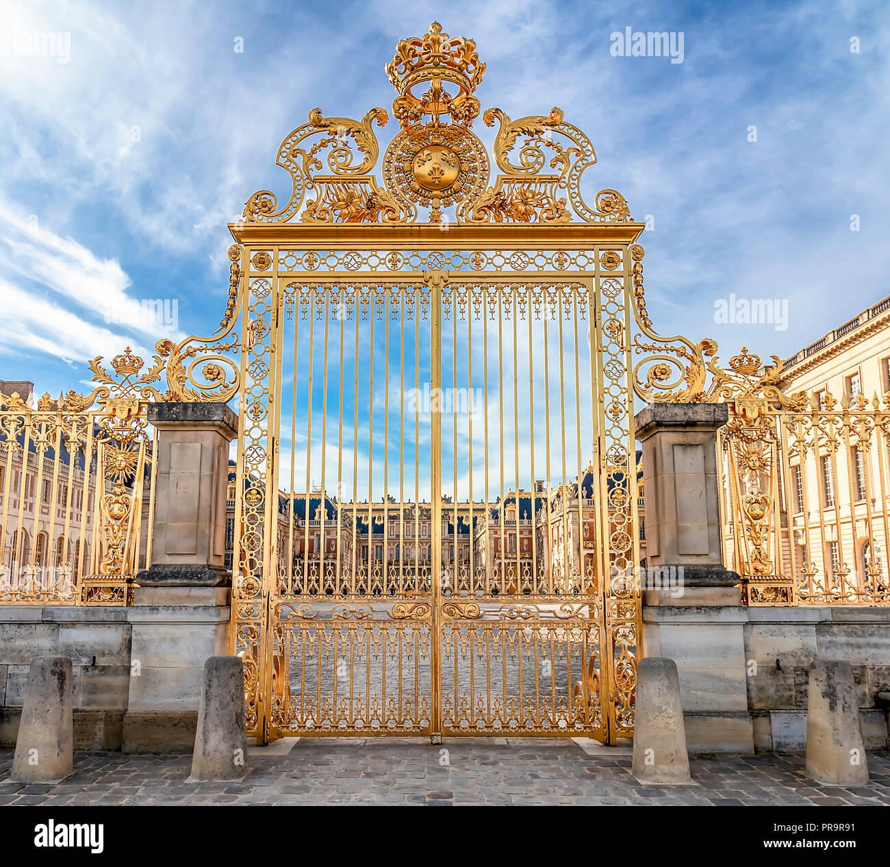 Main golden door in exterior facade of Versailles Palace, Paris, France Stock Photo