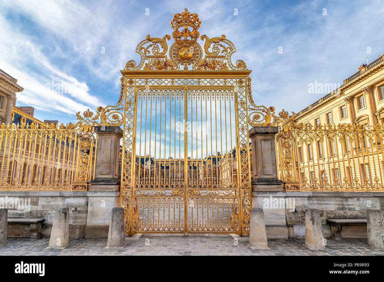 Main golden door in exterior facade of Versailles Palace, Paris, France - Stock Image