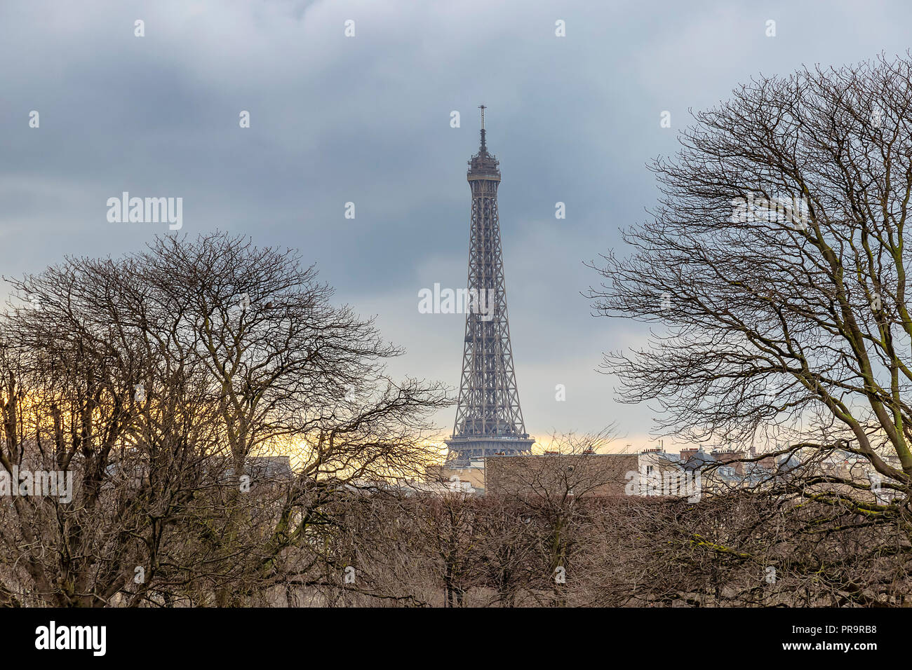 Sunset in Paris, in winter, with Eiffel tower in the far view - Stock Image