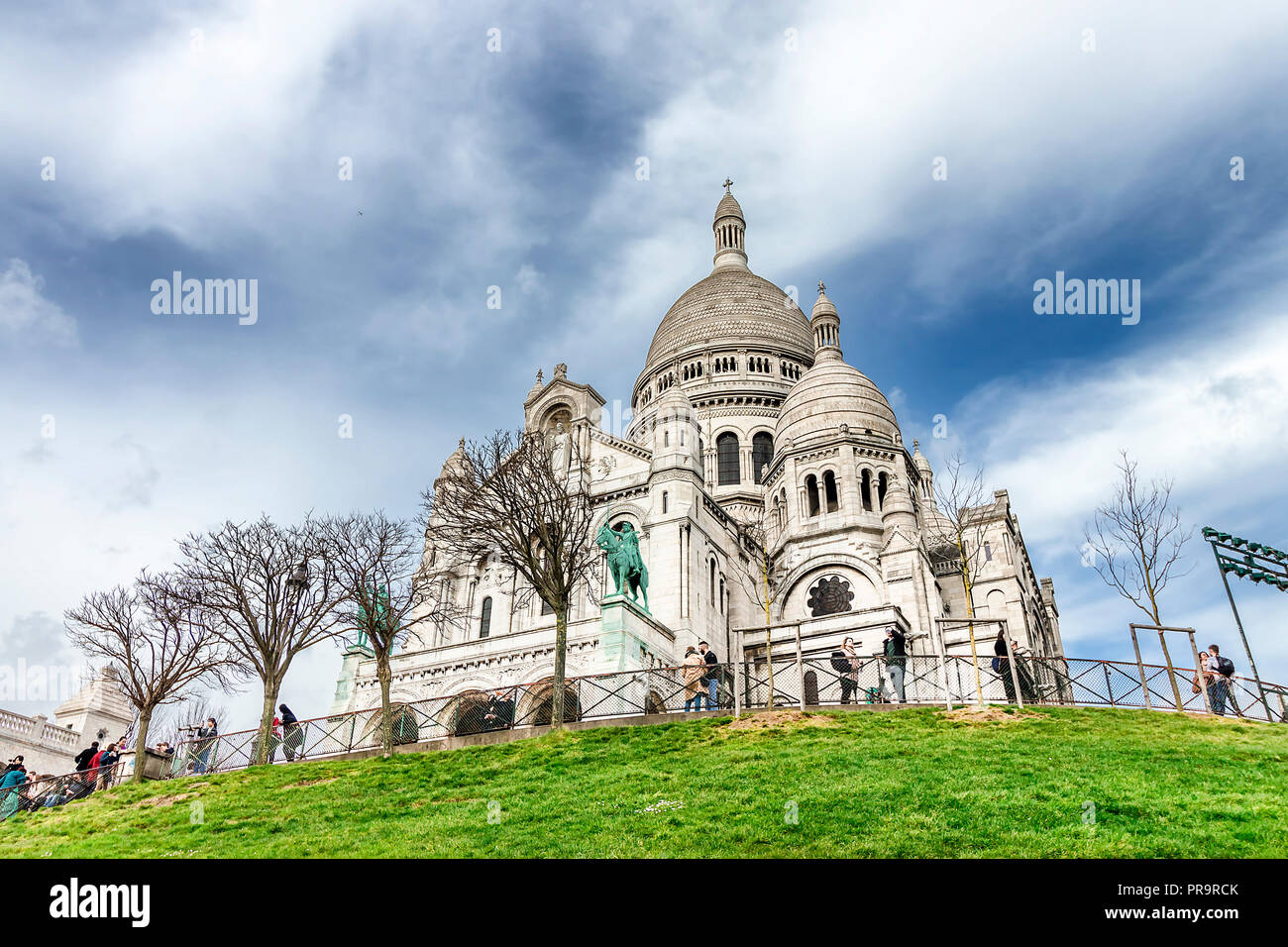 Paris, France - March 14, 2018: The Basilica of the Sacred Heart of Paris is a Roman Catholic church and minor basilica, dedicated to the Sacred Heart - Stock Image