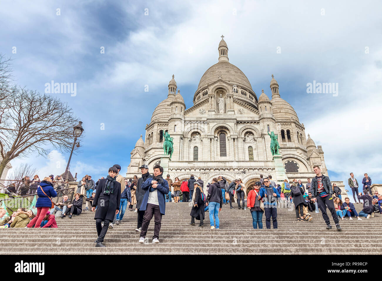 Paris, France - March 14, 2018:  The Basilica of the Sacred Heart of Paris is a Roman Catholic church and minor basilica, dedicated to the Sacred Hear Stock Photo