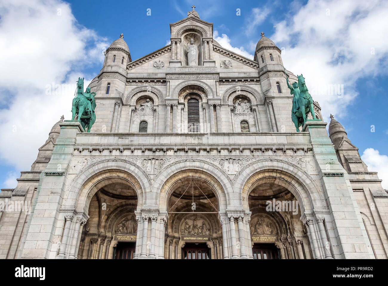 Facade of The Basilica of the Sacred Heart of Paris is a Roman Catholic church and minor basilica, dedicated to the Sacred Heart of Jesus, Stock Photo