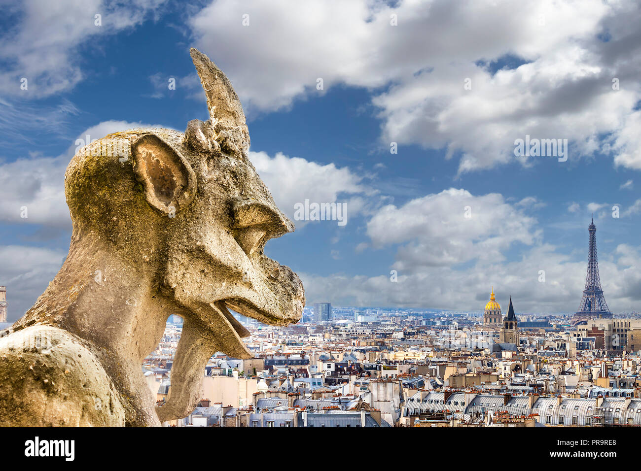 Gargoyle looking to Eiffel tower Stock Photo