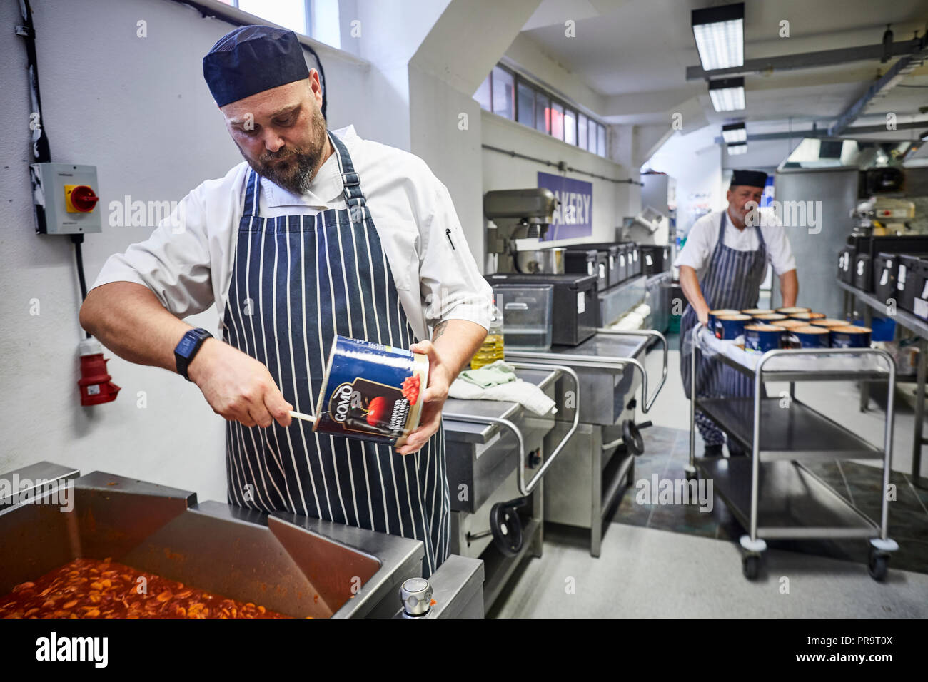 Chef Tony at work in the kitchen to Can Cook Kitchen in Garston, Merseyside - Stock Image