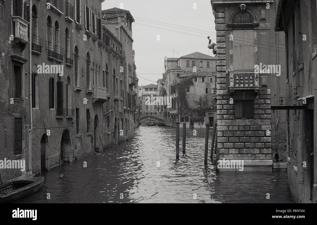 1970s, a view of the buildings anc canals in Venice, the capital of the Veneto region of Italy and an amazing city built in the middle of a lagoon, an enclosed bay of the Adriatic sea with no roads, just canals. - Stock Image