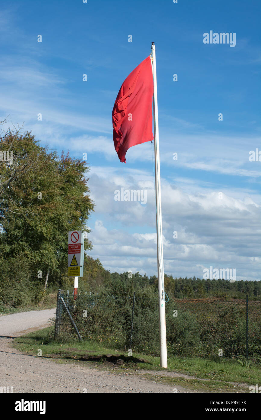 Woolmer Forest landscape, with red danger flags flying. The site is used for military training, and is a Site of Special Scientific Interest (SSSI) - Stock Image