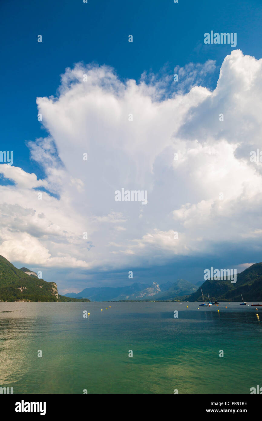 Dramatic sky with clouds over beautiful alpine lake Wolfgangsee in Austria - Stock Image