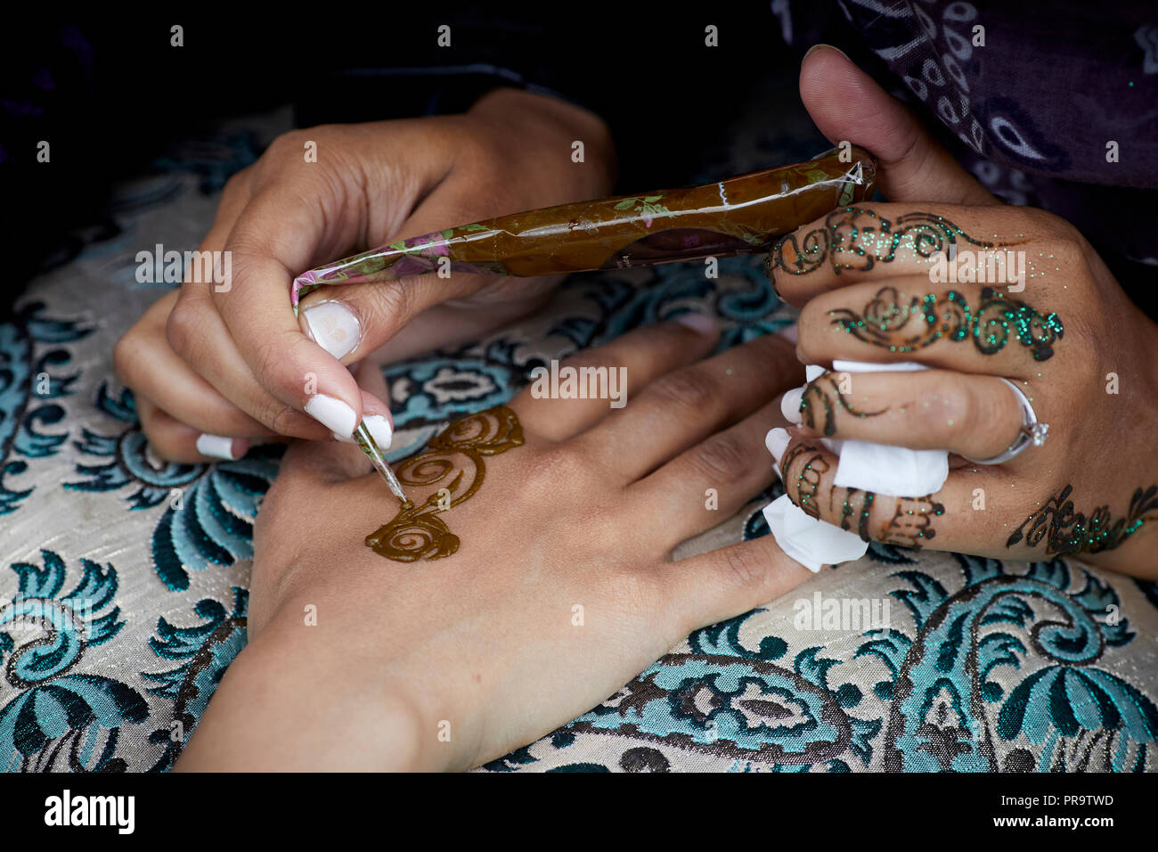 Hemp Tattoo, henna tattooing from the plants dried leaves - Stock Image