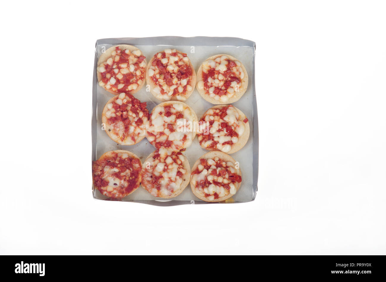 Tray of microwave cooked Mini Bagel Pizza Bites with tomato sauce, mozzarella cheese and pepperoni - Stock Image
