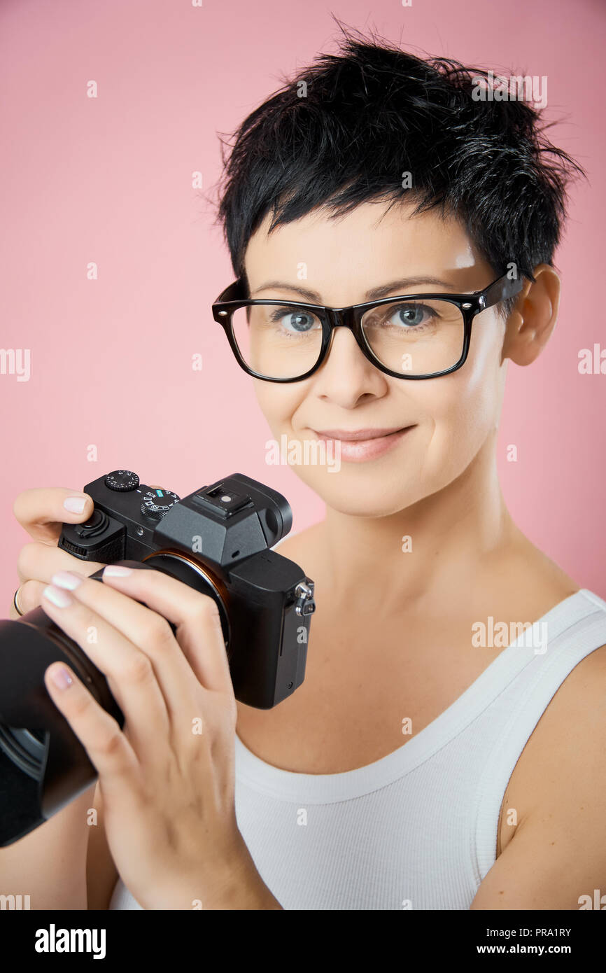 Beautiful Woman In Glasses And With Short Hair With A Camera