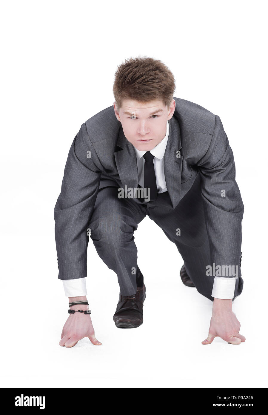 Businessman taking low start to running. On white background. - Stock Image