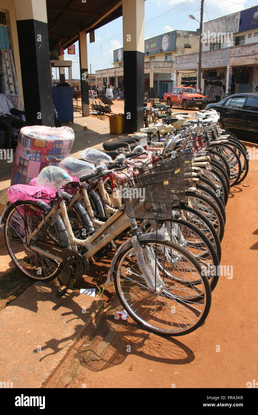 A row of bicycles for sale in the town of Gulu, Northern Uganda. For many people, bicycles provide their main form of transport and are highly valued. - Stock Image