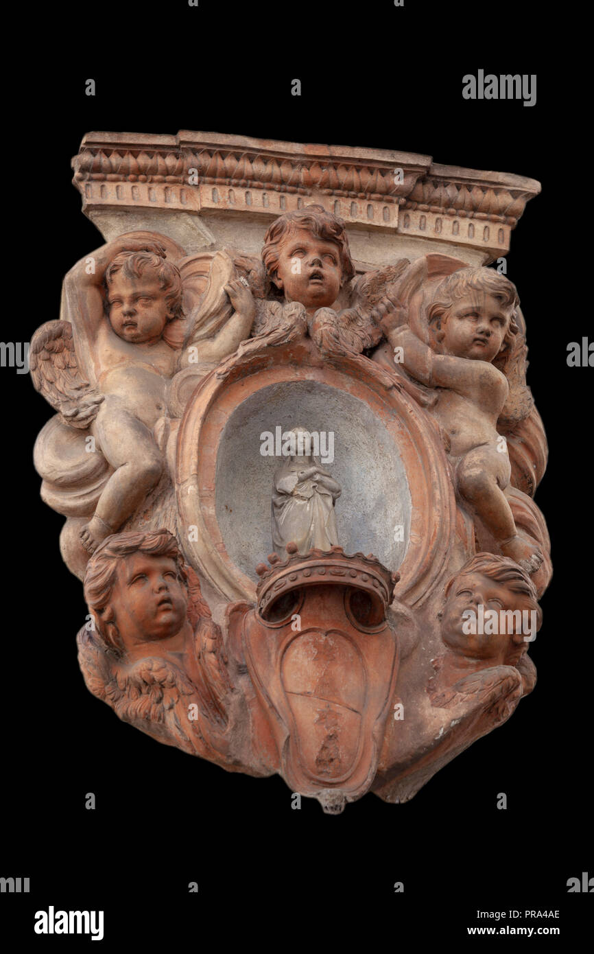 At a street corner of Florence (Oltrano - Florence - Toscane- Italie), an ancient wall medallion made of terracotta showing a Pietà with cherubs. - Stock Image