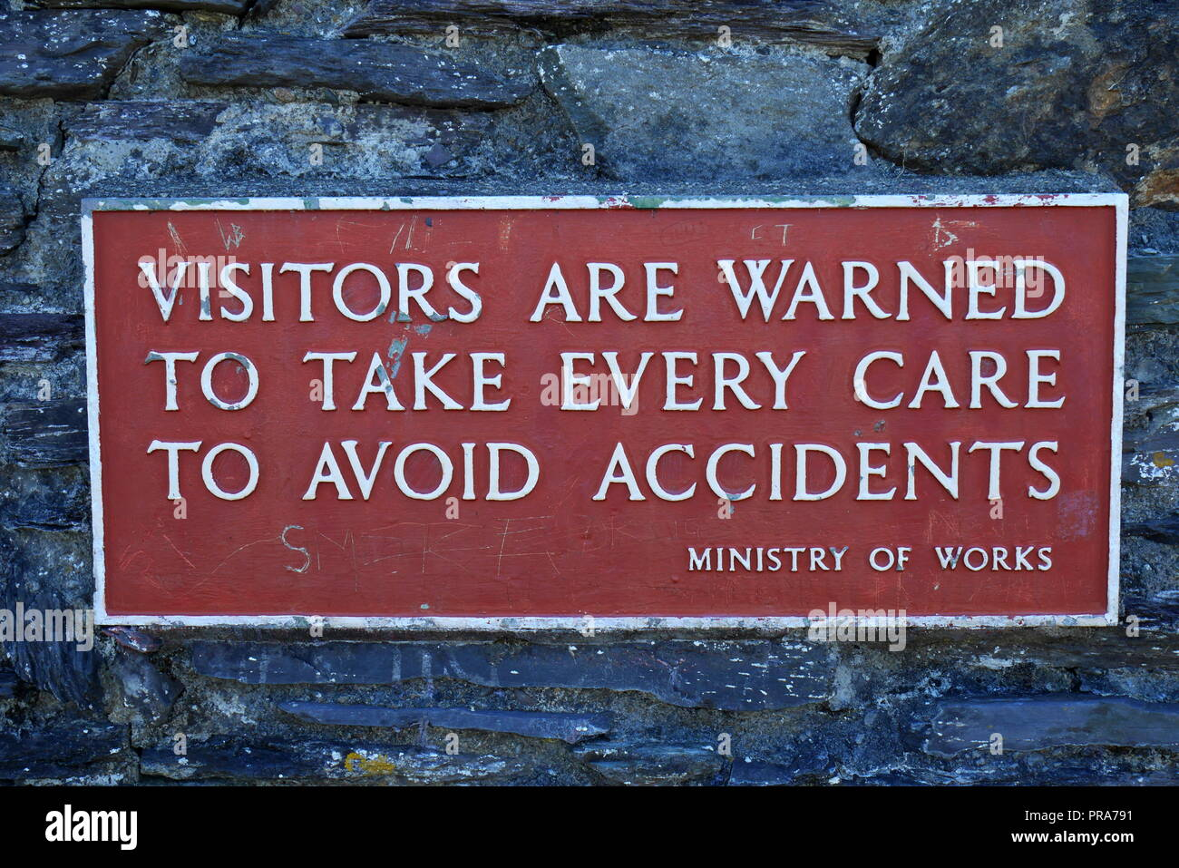 Ministry of Works warning sign: Visitors are warned to take every care to avoid accidents, Dolbadarn Castle, Llanberis, Gwynedd, North Wales, UK - Stock Image