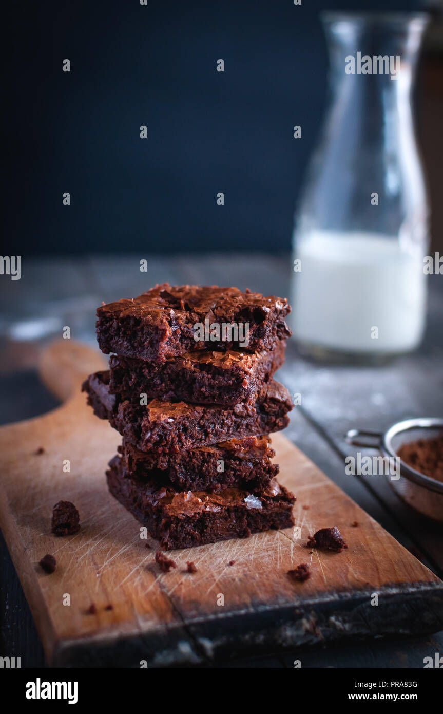 Close-up of homemade chocolate brownies on cutting board Stock Photo