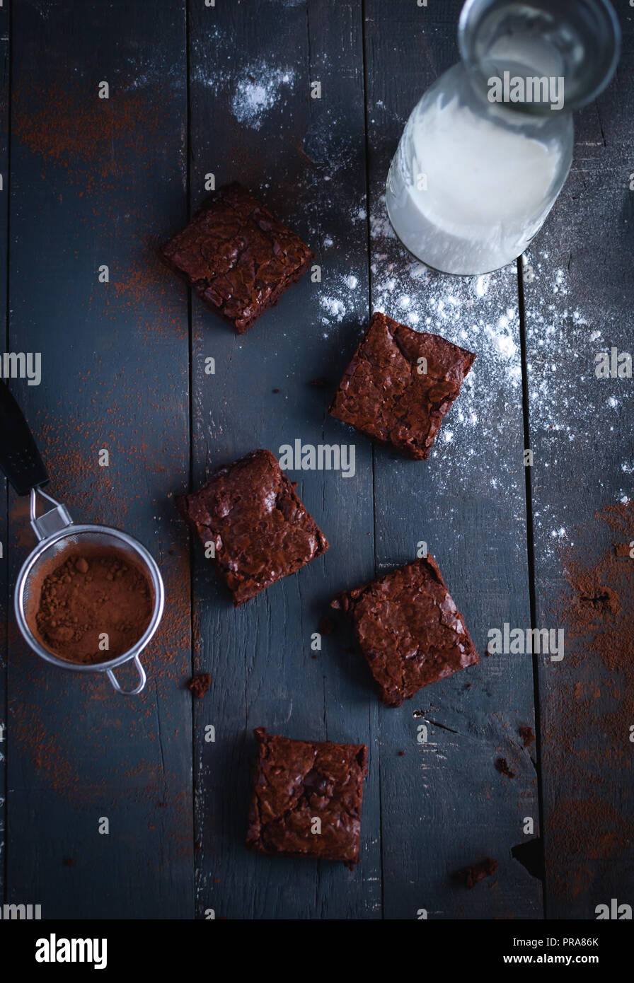 Homemade brownies on dark background, top view Stock Photo