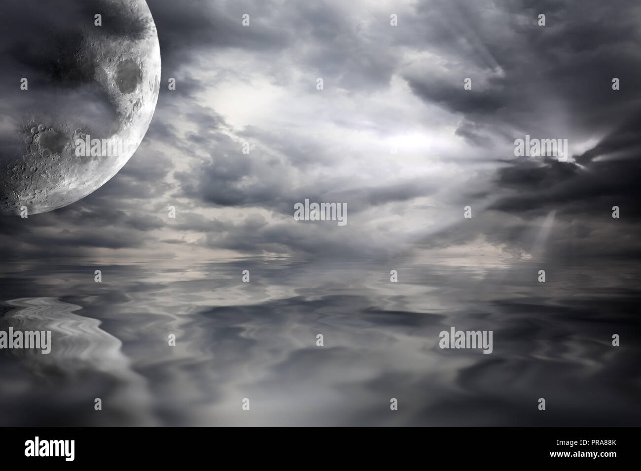 Big moon over water scifi landscape with storm clouds. Black and white fantasy waterscape with reflections of the planet in the sea - Stock Image