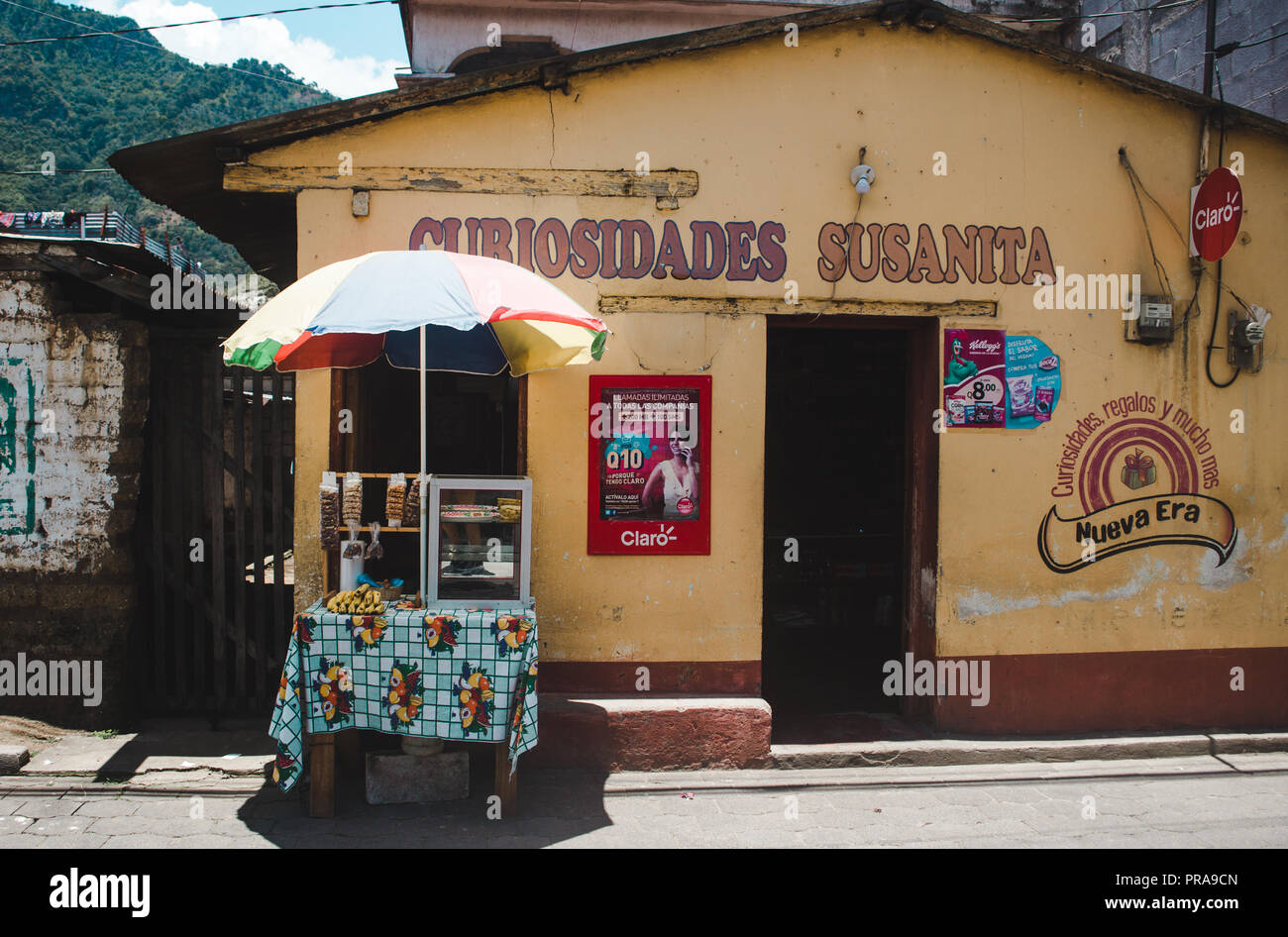 Nuts and fruit being sold on a small small outside a locally-owned convenience shop in San Juan, a town on Lake Atitlán - Stock Image