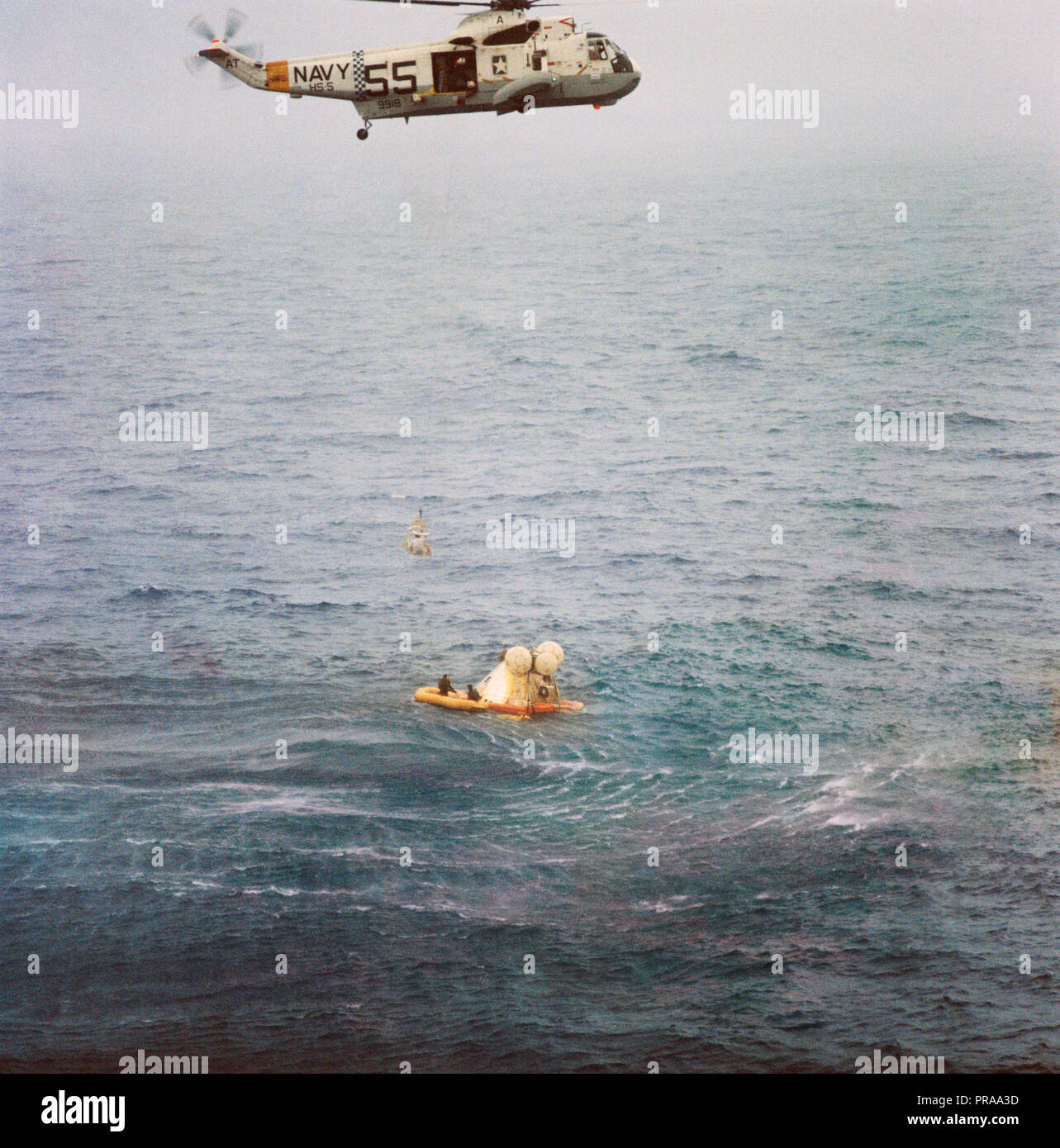 A member of the Apollo 7 crew is hoisted up to a recovery helicopter from the USS Essex during recovery operations. The Apollo 7 spacecraft splashed down at 7:11 a.m., Oct. 22, 1968, approximately 200 nautical miles south-southwest of Bermuda. Photo credit: NASA - Stock Image