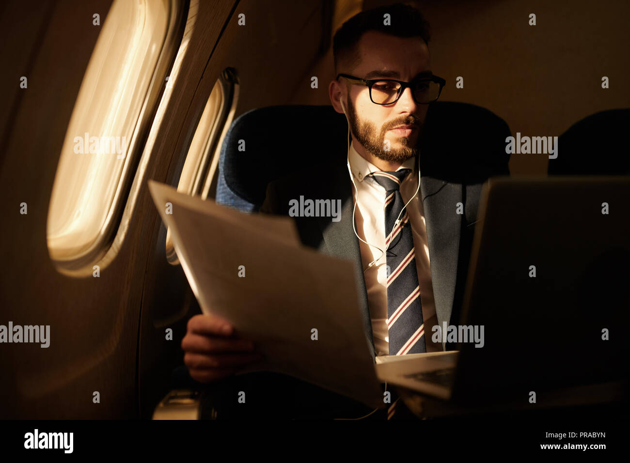 Businessman in Private Jet - Stock Image