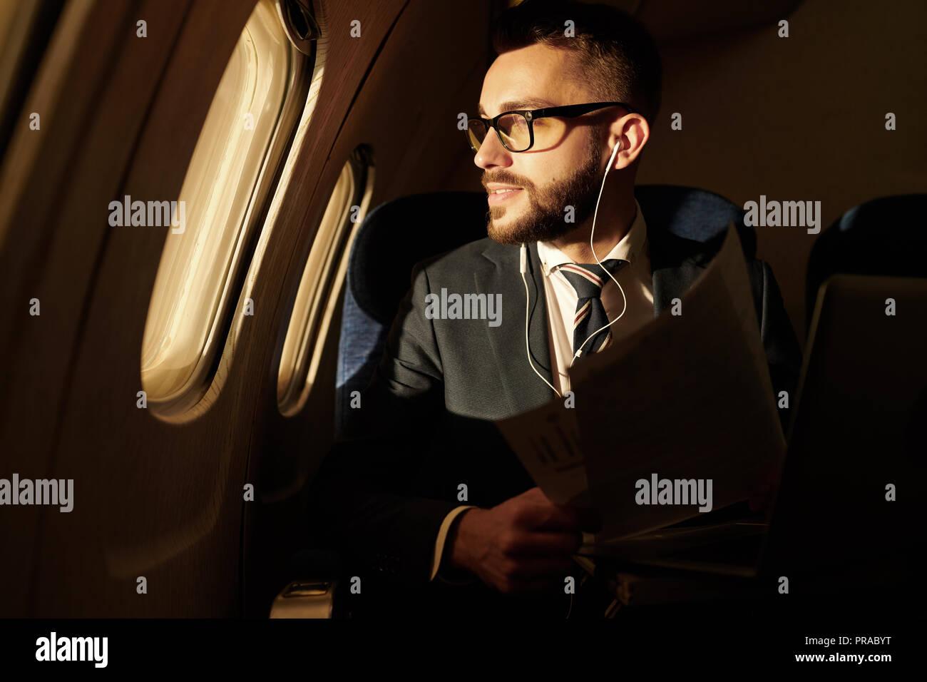 Businessman Enjoying Flight - Stock Image