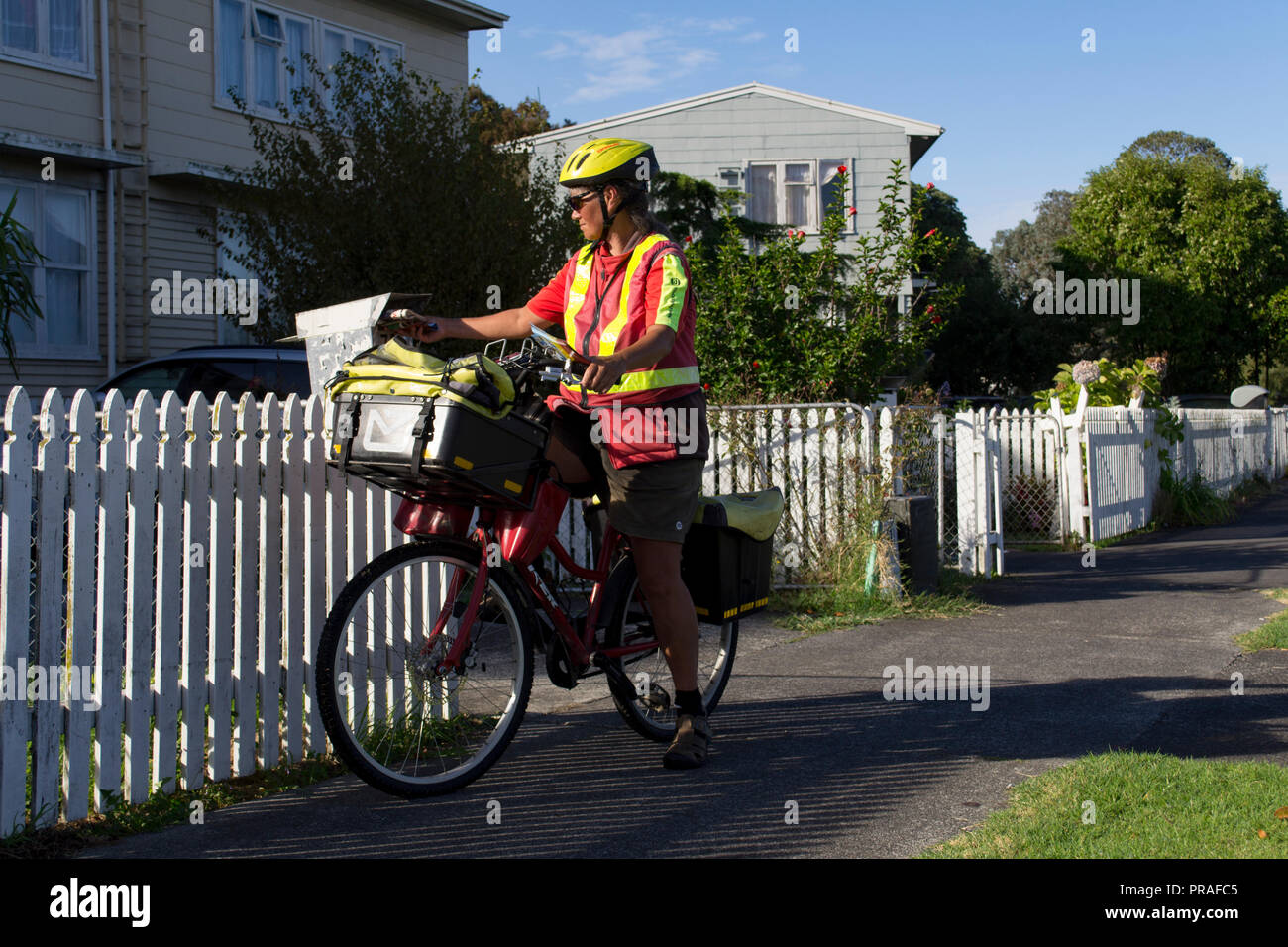 Auckland, New Zealand. Postal worker in the suburbs - Stock Image