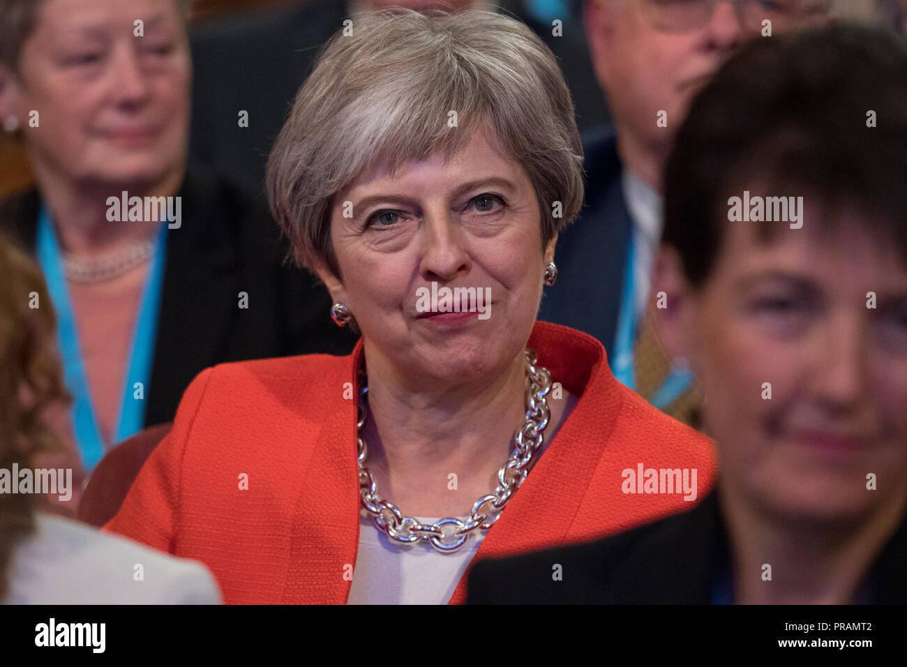 Birmingham, UK. 30 September 2018 - Prime Minister Theresa May watches Brandon Lewis at the Conservative Party Conference 2018 in Birmingham ICC. At times she is seen smiling and frowning, looking angry, and closing her eyes. Credit: Benjamin Wareing/Alamy Live News - Stock Image
