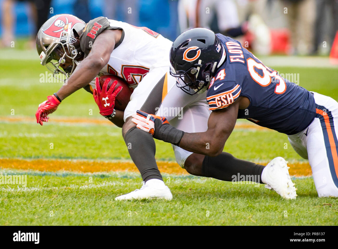 14d8feda52f Bears #94 Leonard Floyd tackles Buccaneers #25 Peyton Barber during the NFL  Game between the Tampa Bay Buccaneers and Chicago Bears at Soldier Field in  ...