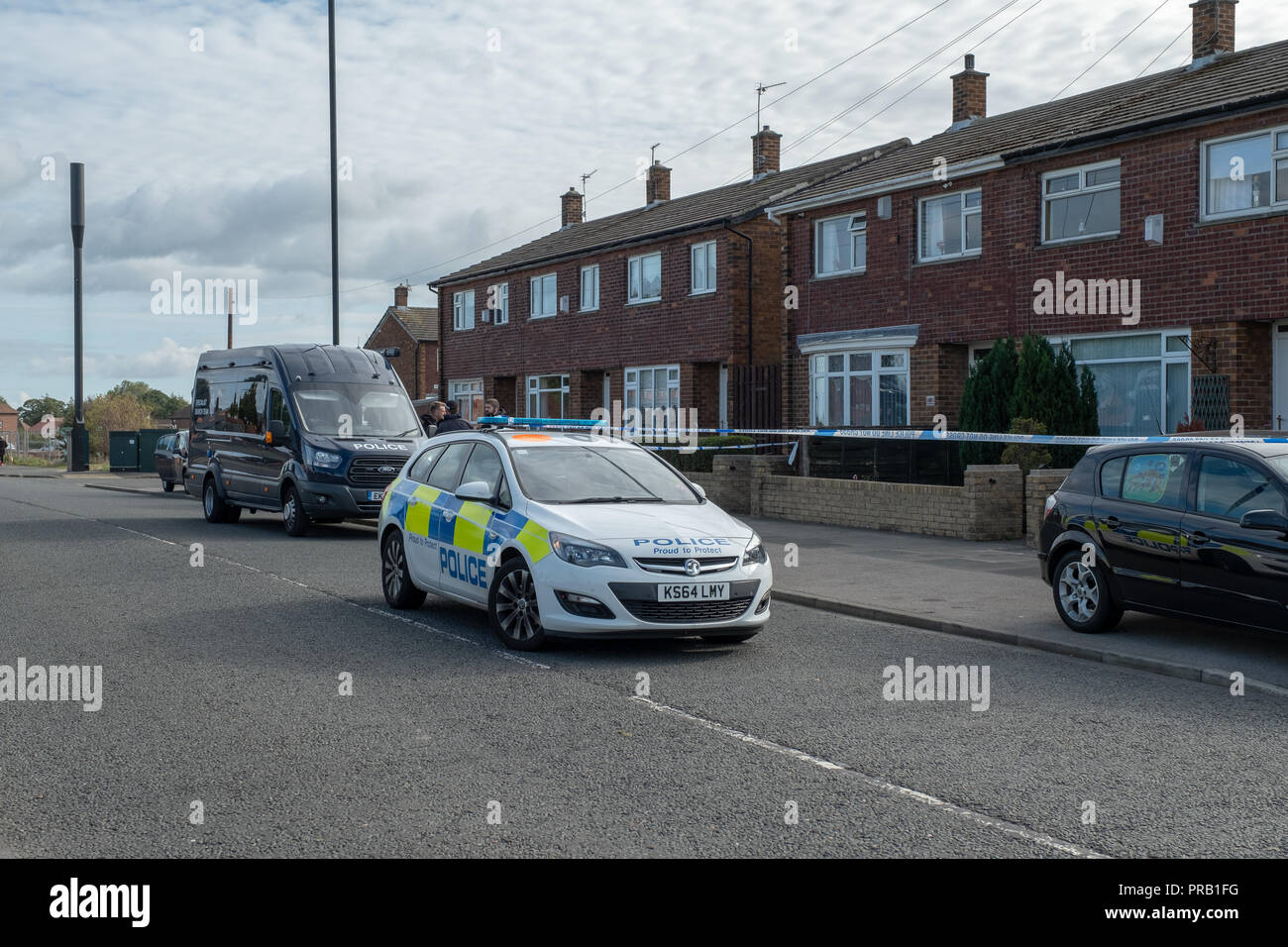 Sunderland Home Sealed off by Police - People reported hearing a loud bang on what is now suspected as gun shots in the street (Fordfield Road, Sunderland) and armed offices attended the incident last night (30 September at around midnight) .  Specialist officers are at the scene as enquiries continue with several houses cordoned off following the incident. - Stock Image
