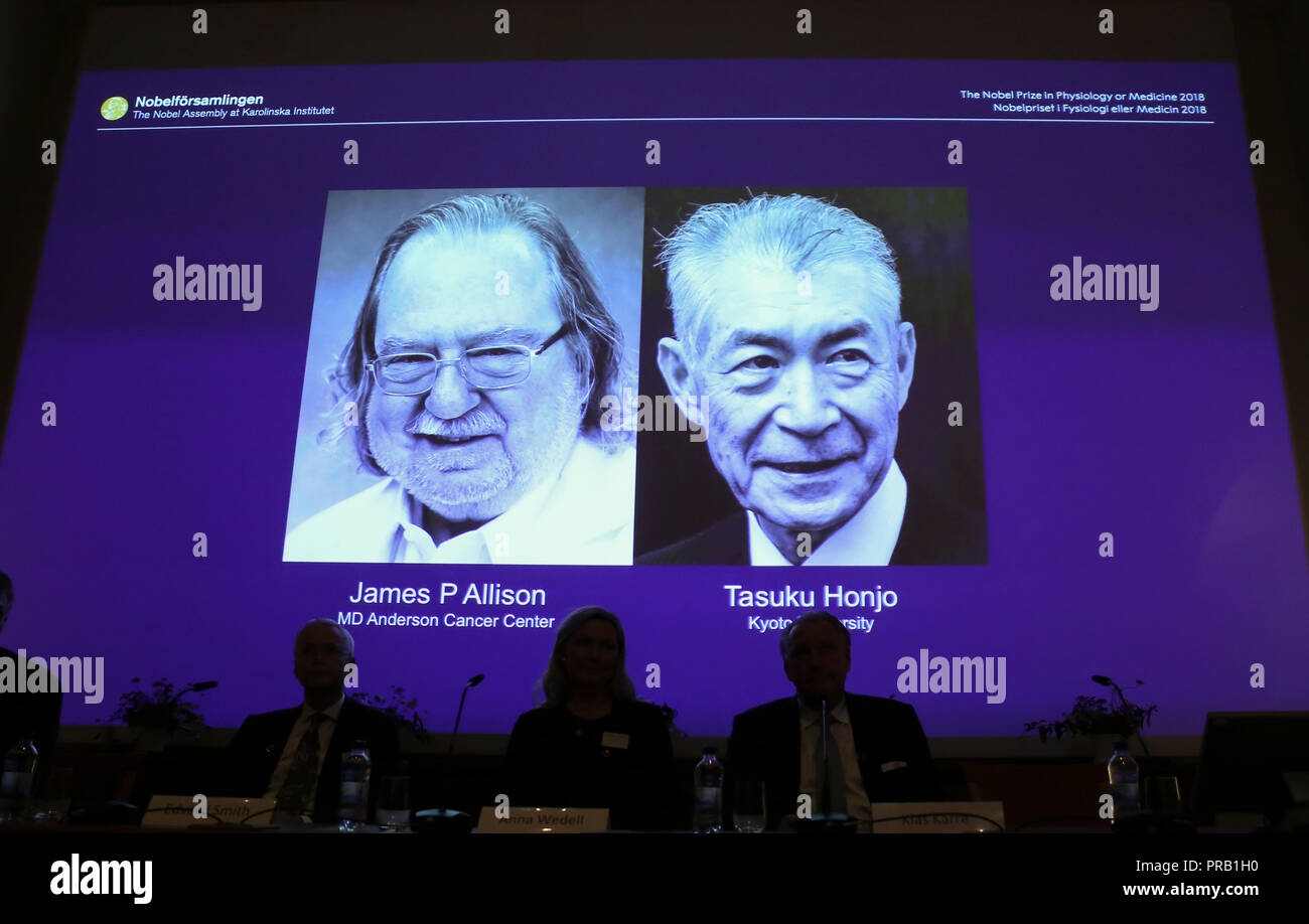 Stockholm. 1st Oct, 2018. Photo taken on Oct. 1, 2018 shows a screen displaying the portraits of two awarded scientists James P Allison (L) of U.S. and Tasuku Honjo of Japan for the 2018 Nobel Prize in Physiology or Medicine during a press conference at the Karolinska Institute in Stockholm, Sweden. The Nobel assembly at the Karolinska Institute has decided to award the 2018 physiology or medicine prize jointly to James P. Allison and Tasuku Honjo for their discovery of cancer therapy by inhibition of negative immune regulation. Credit: Ye Pingfan/Xinhua/Alamy Live News Stock Photo