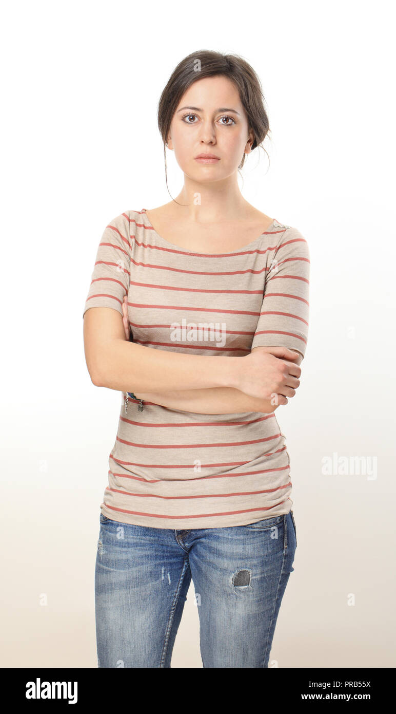 e05993f2db Sad woman wearing in striped blouse and blue jeans Stock Photo ...