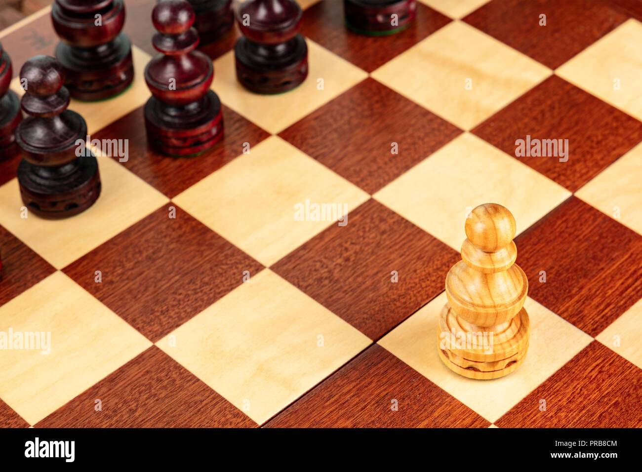 A pawn on a chessboard, a metaphor for the first step - Stock Image