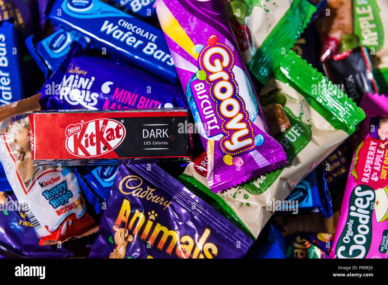 Assorted candy chocolate bars in brightly coloured wrappers. - Stock Image