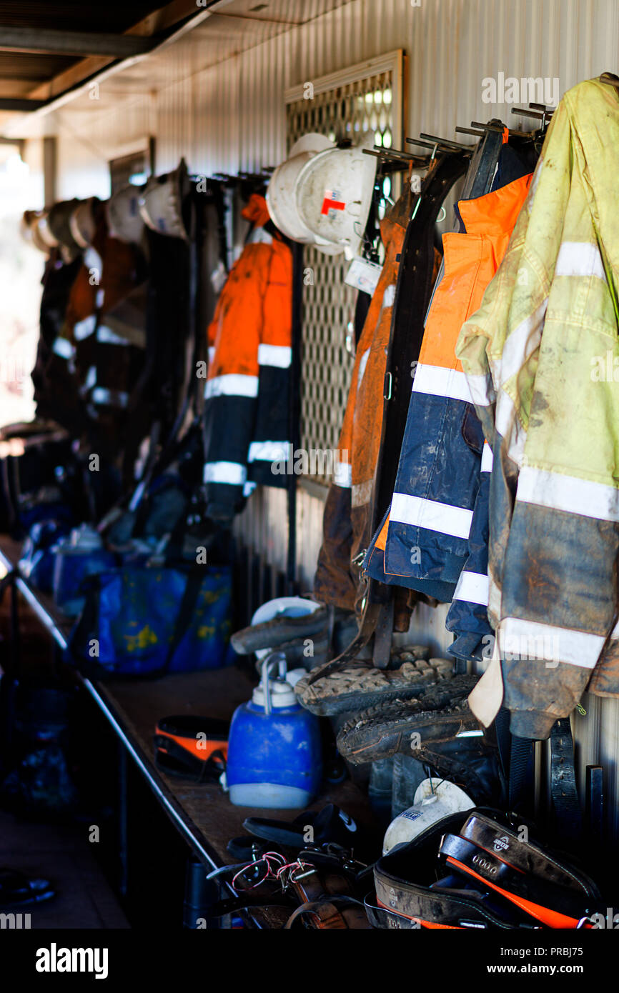 Miners clothing and personal items and safety equipment hanging up at Gold Mine in Western Australia - Stock Image