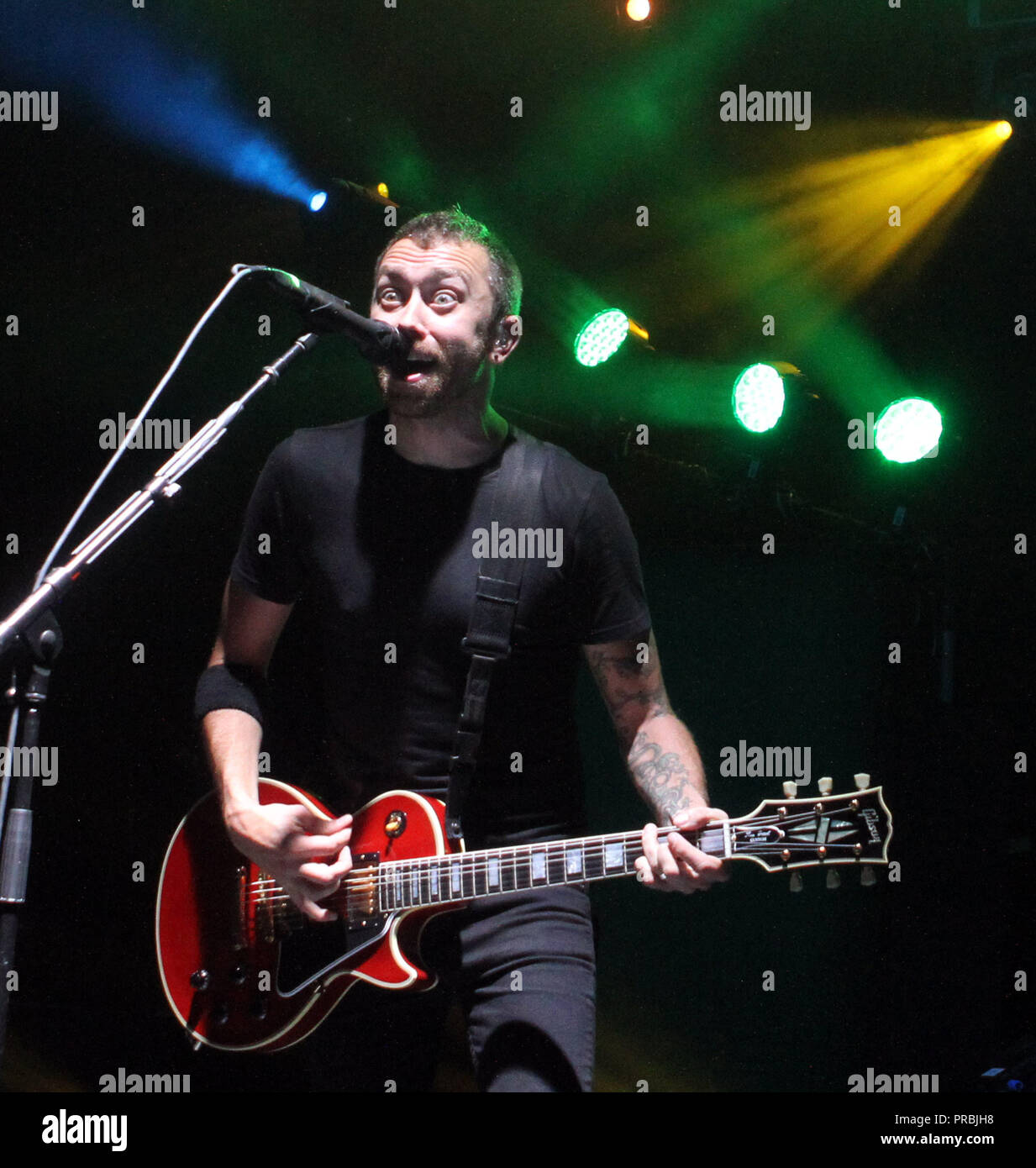 Tim Mcllrath with Rise Against performs at the Sunset Cove Amphitheater in Boca Raton, Florida on April 28, 2011. - Stock Image