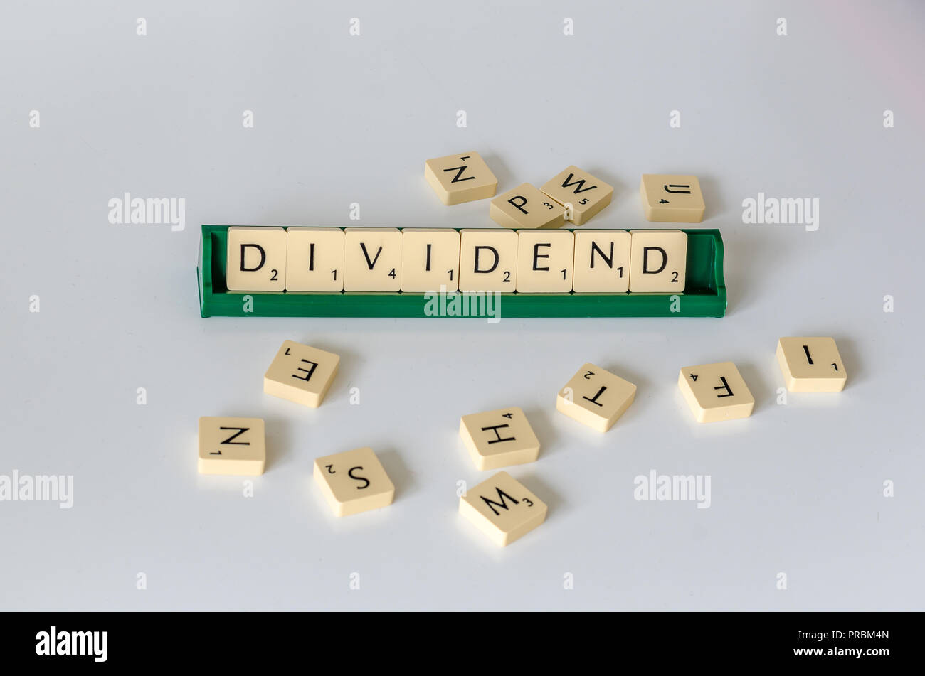 Text dividend in scrabble letters. - Stock Image