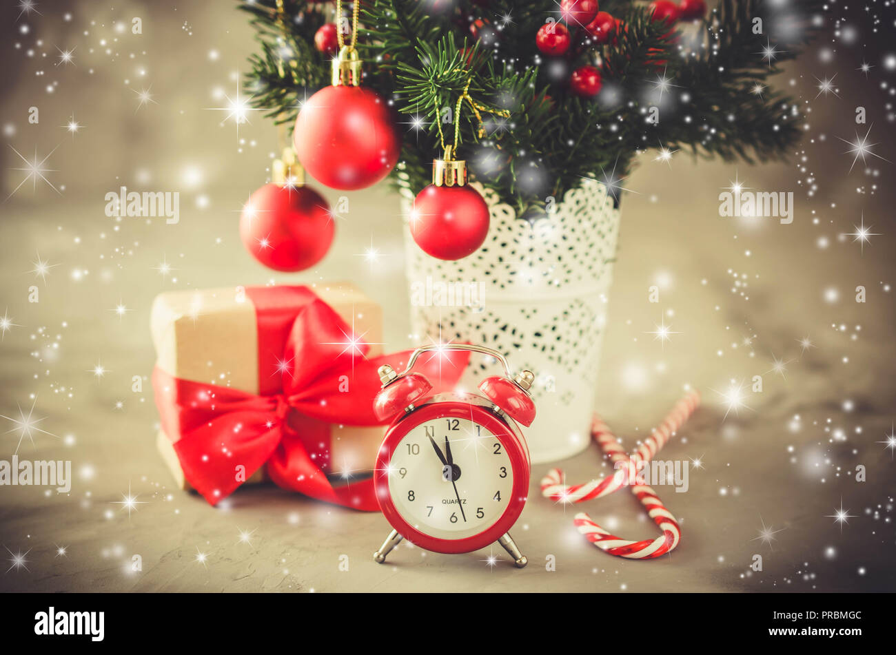 christmas composition xmas fir branches alarm clock gift box and decorations in the