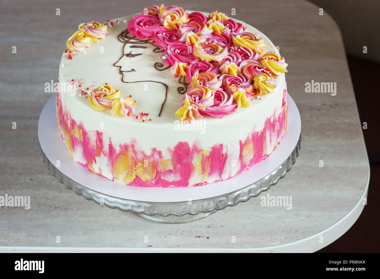 Festive Cake With Cream Flowers And A Girl Face On Light Background