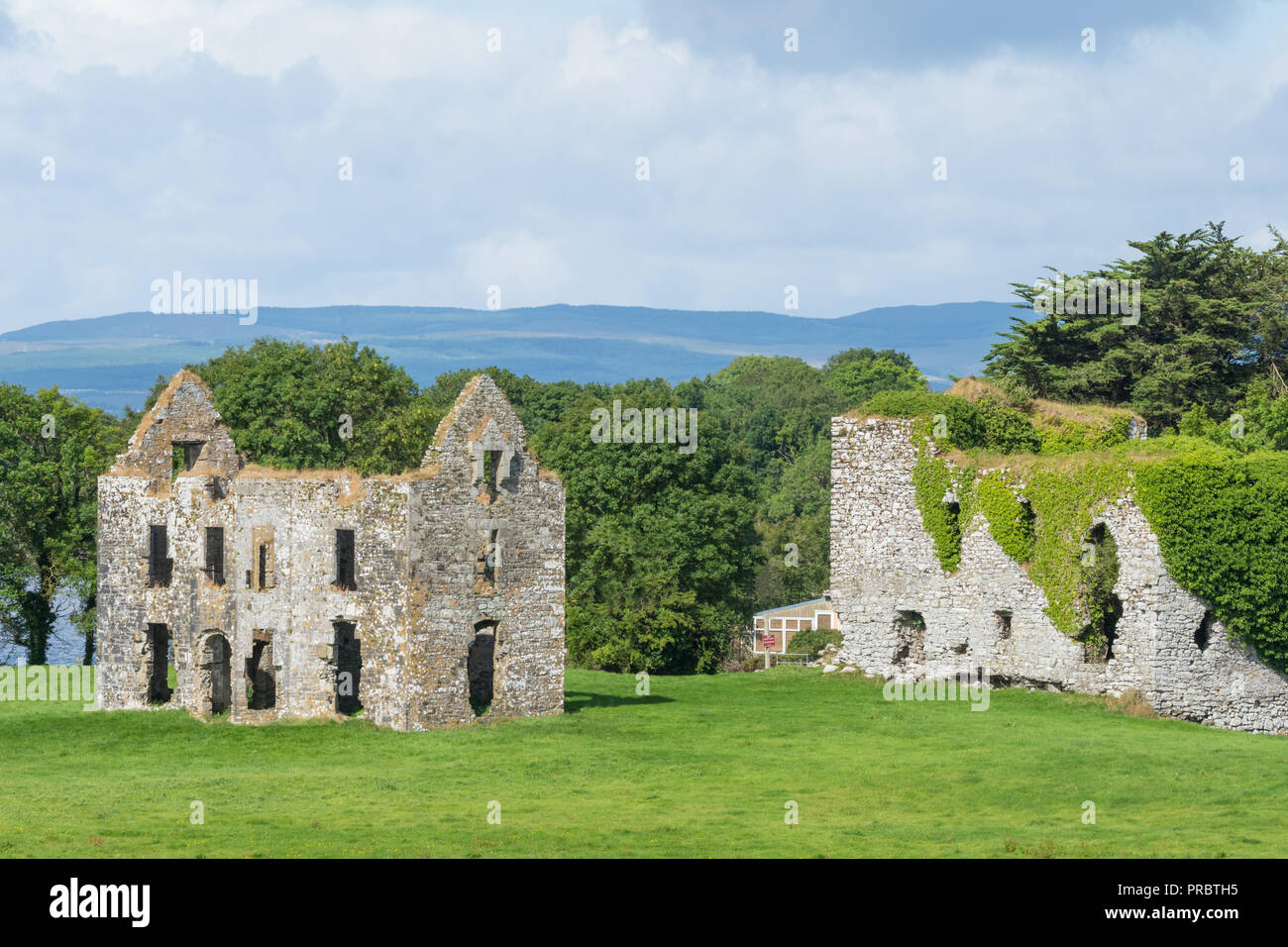 A view of Annaghkeen Castle, situated next to Lough Corrib in County Galway in Ireland. Stock Photo
