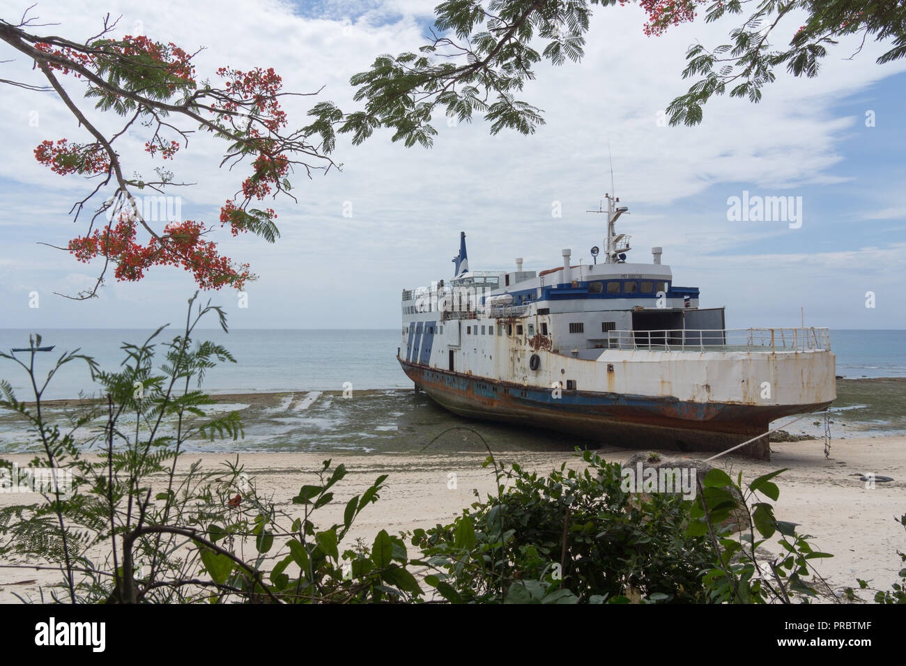 an old ferry between Unguja and Pemba islands in Zanzibar, that had run aground on the north western coast of Unguja - Stock Image