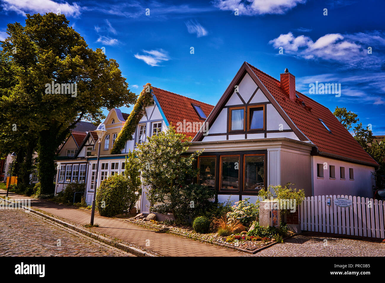 Row of small houses on a cobblestone street as seen in this tourist town Stock Photo