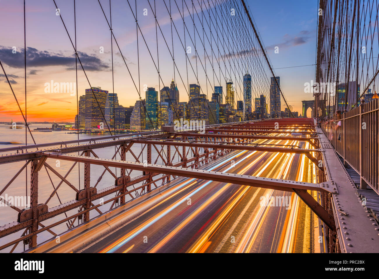 New York, New York, USA Lower Manhattan skyline after sunset from the Brooklyn Bridge. - Stock Image
