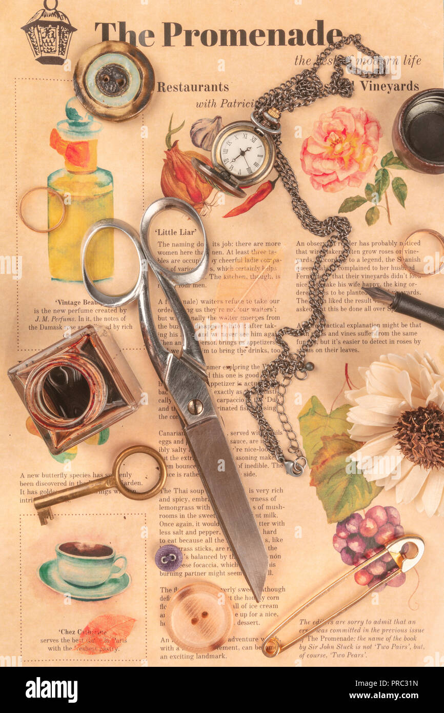 Various vintage objects, shot from above on an old newspaper - Stock Image