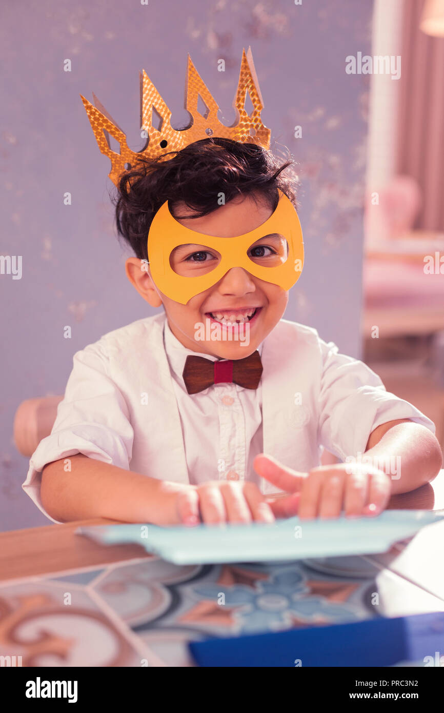 5a691cf0196d8 Happy boy wearing paper crown and enjoying little carnival Stock ...