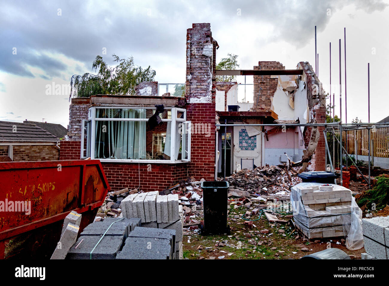 1960's house being completely taken apart before being rebuilt - Stock Image