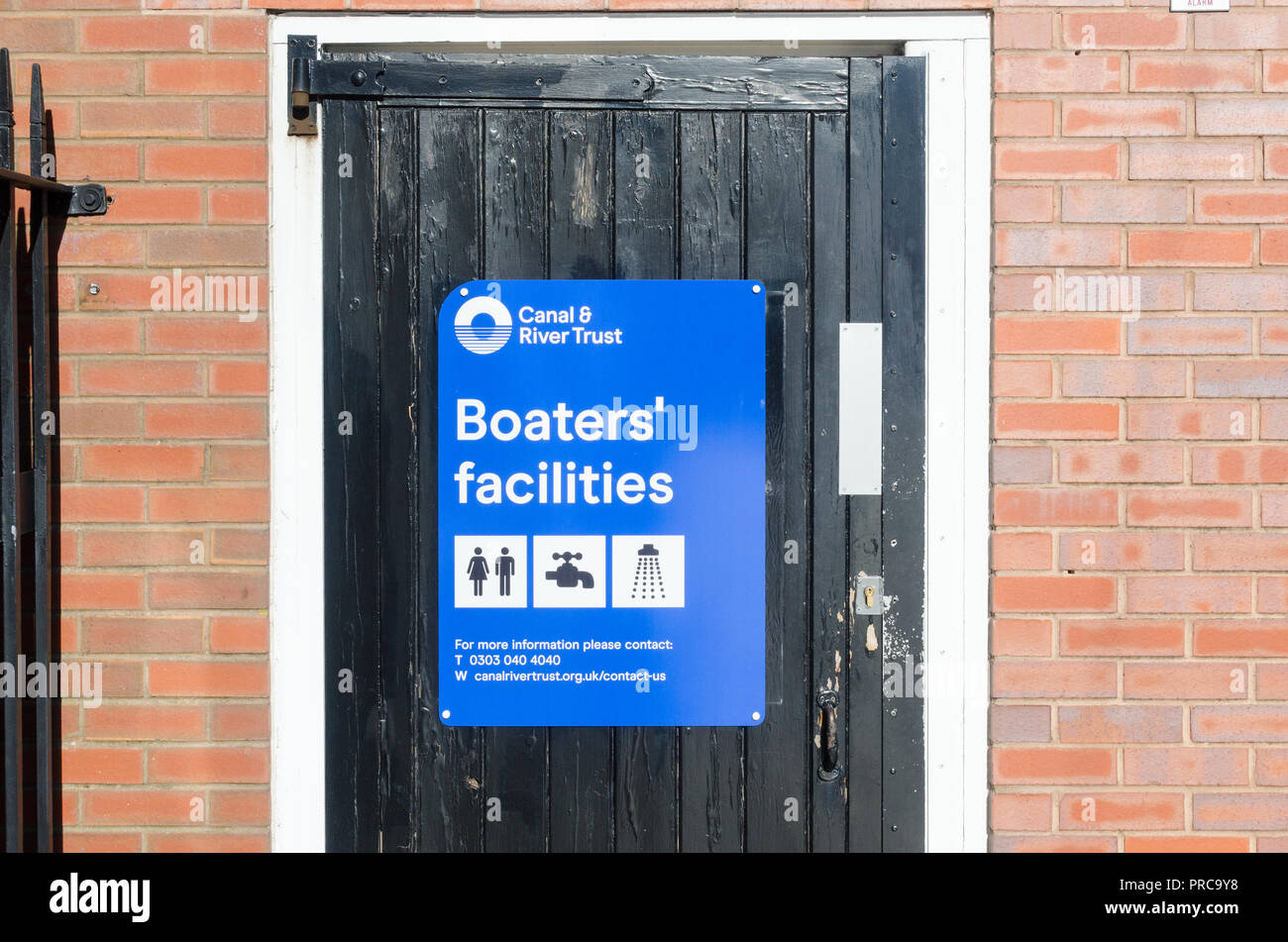 Blue Canal and River Trust sign for boaters' facilities on the canal towpath in Birmingham city centre - Stock Image